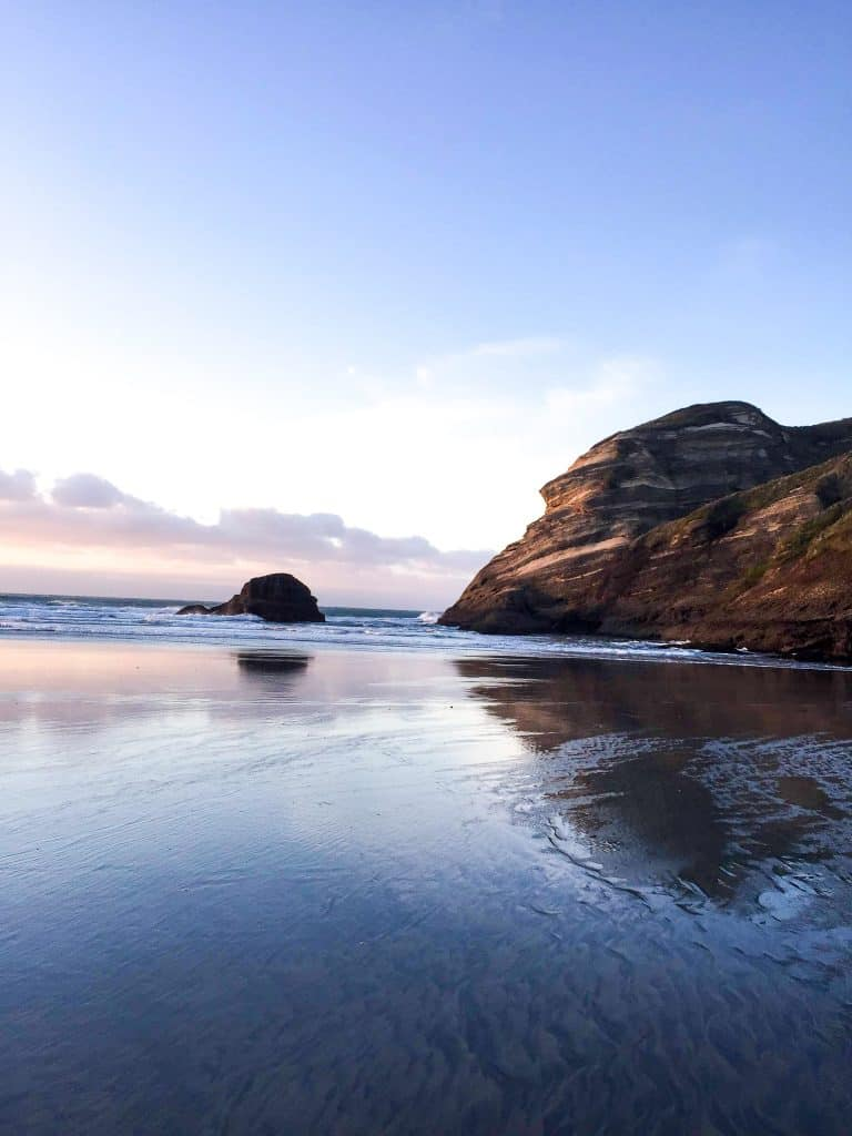 a photo of wharariki beach in collingwood one of the best things to do in golden bay