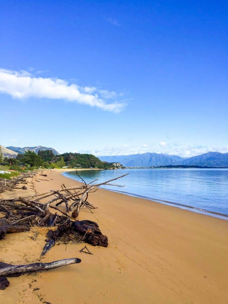 a beautiful photo of the golden sanded tata beach in golden bay nz