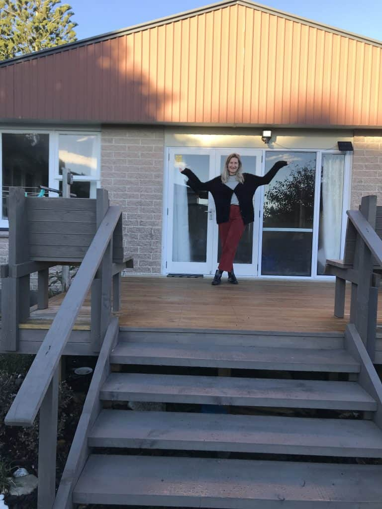 a photo of me outside my favourite airbnb accommodation option in the west coast south island