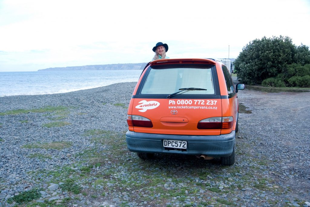 a photo of me sticking my head out of one of my favourite Cheap New Zealand campervan hire with spaceships rentals