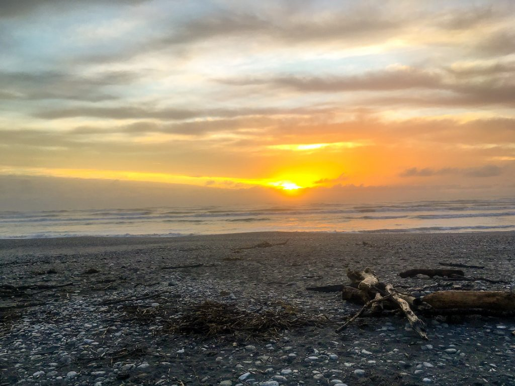 a beautiful photo of greymouth beach at sunset