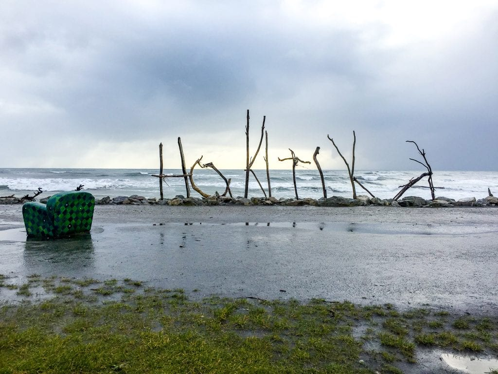 Hokitika beach is one of the best things to do in the west coast and this is a photo of the iconic drift wood sign