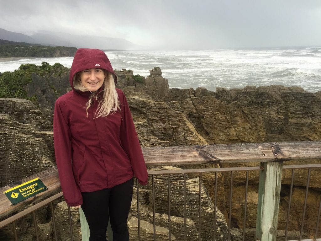 another photo of me standing infront of a barrier at pancake rocks which is one of the best things to do in greymouth on the west coast