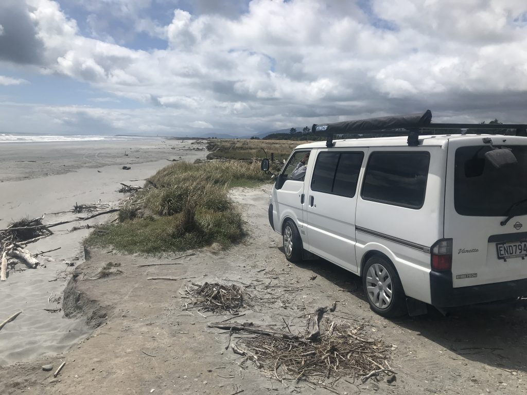 A photo of my campervan on a west coast south island beach