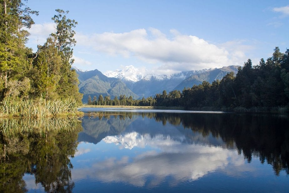 A stunning photo of Lake Matheson which is probably one of the most popular destinations and things to do in the west coast