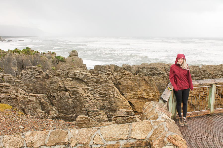 a photo of me standing in front of a barrier at pancake rocks one of the best things to do in greymouth region