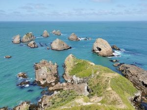 a beautiful photo of nugget point one of the most amazing things to do in Southland