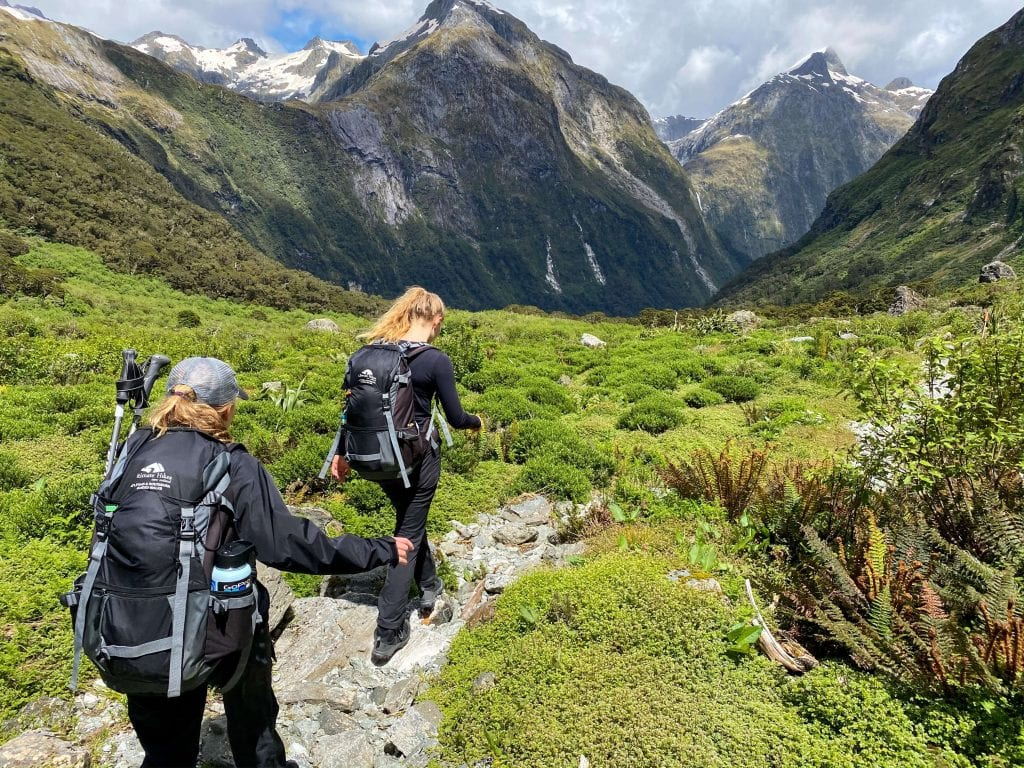 two girls hiking the milford track in the southland region