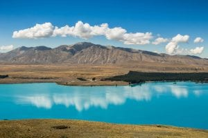 a beautiful photo of lake tekapo when looking for what to do in lake tekapo visiting the lake is first on the list!