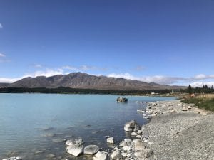 a photo from the waters edge in Lake Tekapo in the Canterbury region new zealand