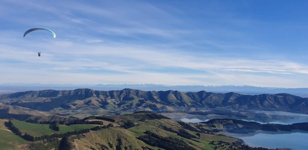 A photo of my brother paragliding in Banks peninsular in the Canterbury region New Zealand