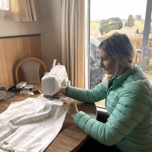 DIY camper curtain guide featuring me sewing!